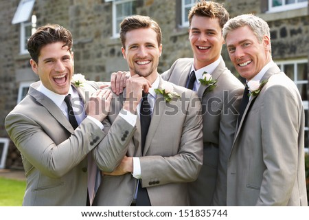 Groom With Best Man And Groomsmen At Wedding - stock photo