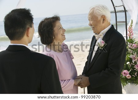 Groom With Parents on Beach