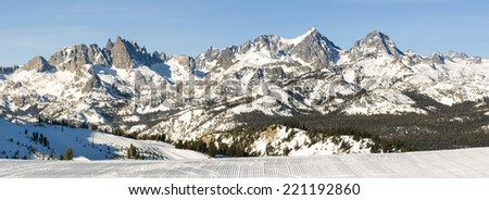 Groomed run looking out over Minaret range in Mammoth Lakes, CA - stock photo