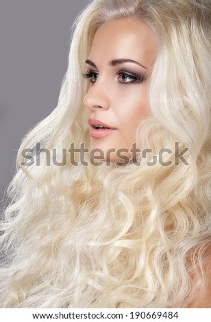 Groomed Woman's Face. Ash-colored Curly Hair