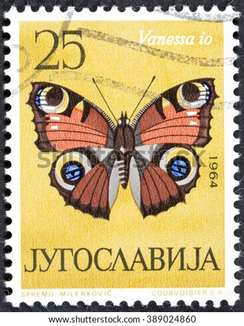 """GROOTEBROEK ,THE NETHERLANDS - MARCH 8,2016 : A stamp printed in Yugoslavia shows butterfly with the inscription """"Vanessa io"""" from the series """"Butterflies"""", circa 1964 - stock photo"""