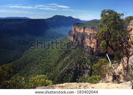 Grose Valley in the Blue Mountains National Park NSW Australia with views to Mt Banks on the northern side.  There's no fences with sheer cliffs  so use caution when at the edges when hiking here. - stock photo