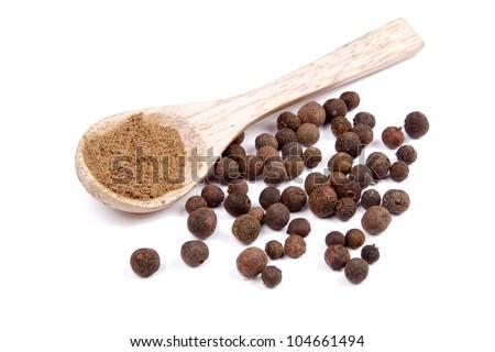 Ground allspice on wooden spoon - stock photo