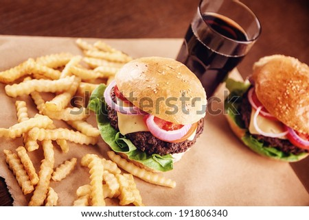 Ground beef Cheese Burger with Lettuce,Tomato and Red Onion with French Fries . - stock photo