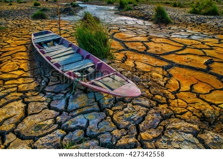 Ground broken by the drought ship aground in hard dramatic tone  - stock photo