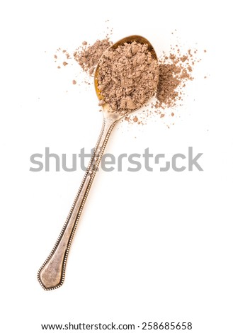 ground cinnamon powder in a spoon on a white background - stock photo