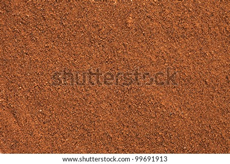 Ground Cinnamon texture, full frame background.  As a spice or condiment cinnamon sold in the form of sticks or a hammer. Used as a spice in cuisines all over the world.