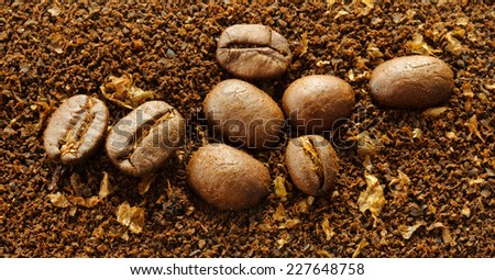 Ground coffee background with coffee beans closeup - stock photo