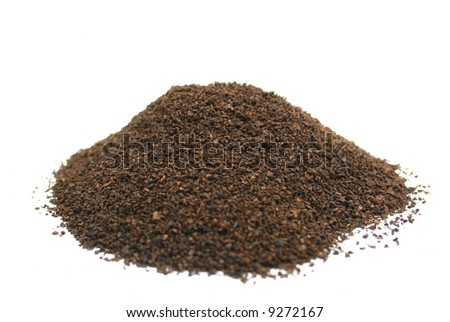 Ground coffee isolated on white background