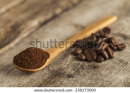 Ground coffee on a wooden spoon  - stock photo