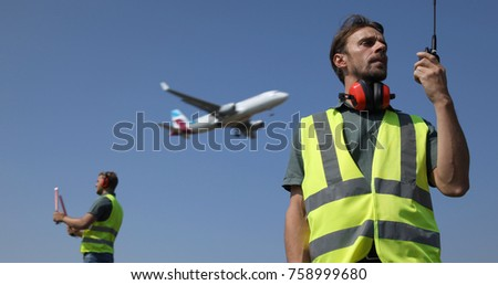 Ground Crew Dialogue with  Air Traffic Control Tower Using a Walkie Talkie, Airport Team Activity, Airplane Flying Over Aircrew Controllers, Aircraft Passing Overhead