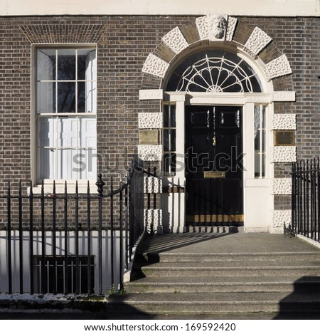 Ground floor entrance facade to 18th century Georgian London townhouse UK.. - stock photo