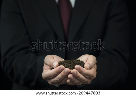 Ground in the hands of businessman
