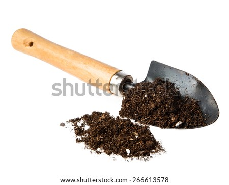 ground in the small shovel isolated on white background - stock photo