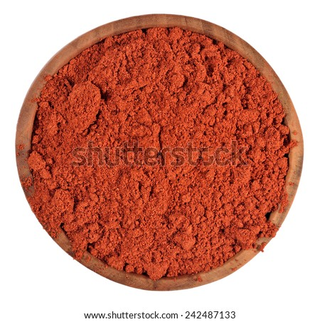 Ground paprika in a wooden bowl on a white background