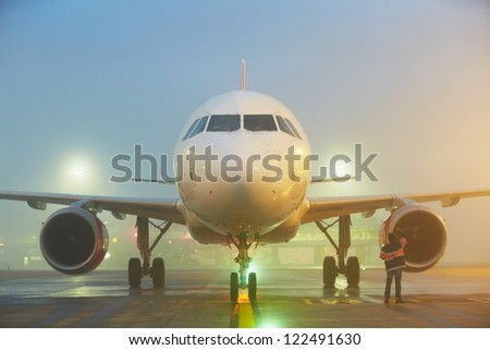Ground staff is checking airplane before take off. - stock photo