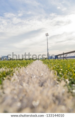 Ground View Of An Empty Stadium Arena With Football Field - stock photo