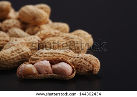 Groundnuts, peanuts on the gray background