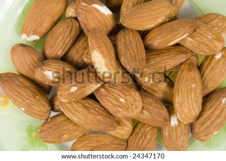 group almonds in brown pod without nutshell