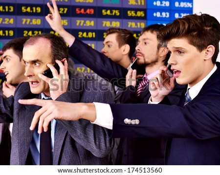 Group business people with  stock exchange board in office. - stock photo