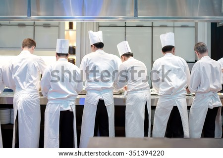 Busy Restaurant Kitchen restaurant kitchen stock images, royalty-free images & vectors