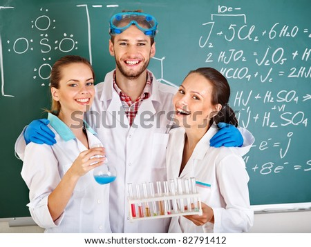 Group chemistry student with flask in classroom. - stock photo