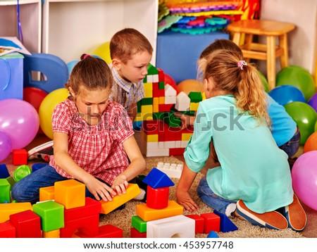 Group children game blocks on floor in primary school. Top view class of primary school. - stock photo