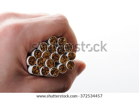 group cigarettes in hand isolated on white background