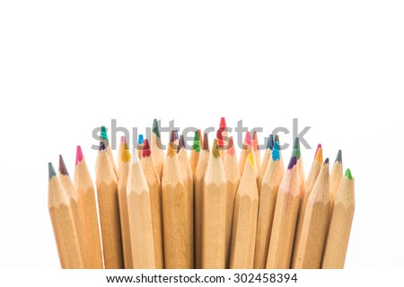 Group Color pencils on white background. Multi culture team concept. - stock photo