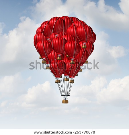 Group concept as a team of red hot air balloons joined together as a symbol for teamwork unity and collaboration solidarity with people being lead by an individual manager. - stock photo