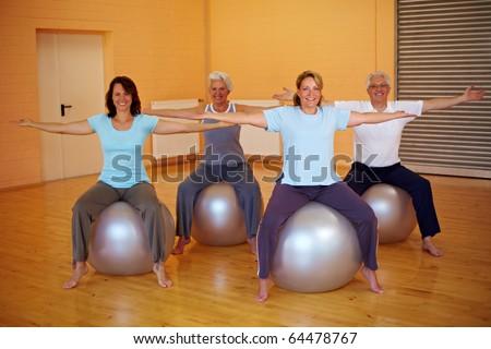Group doing back exercises in a gym