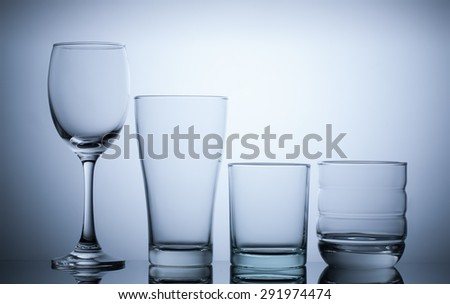 group empty glass on blue light background