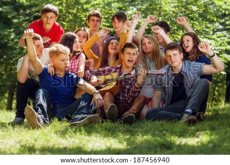Group expressive singing young people - stock photo