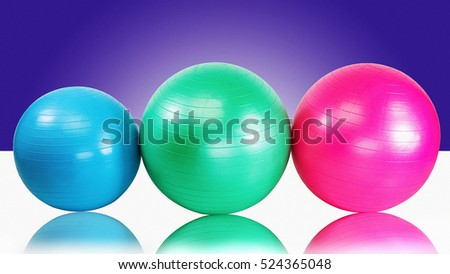 Group fitness balls for health club workout purple background