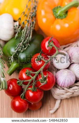 group fresh colored vegetables on wooden table