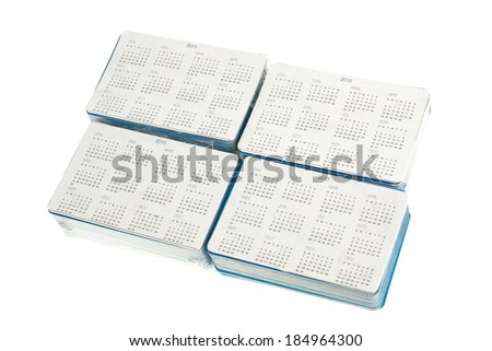 Group from four bundles of pocket calendars isolated on white background