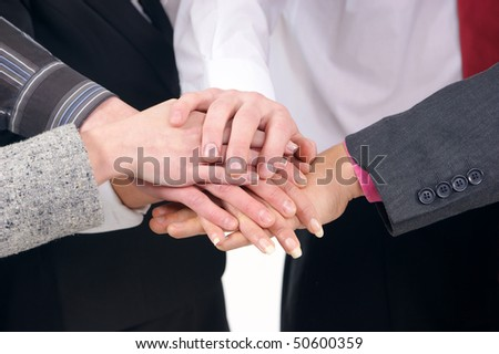 Group handshake with a lot of different hands