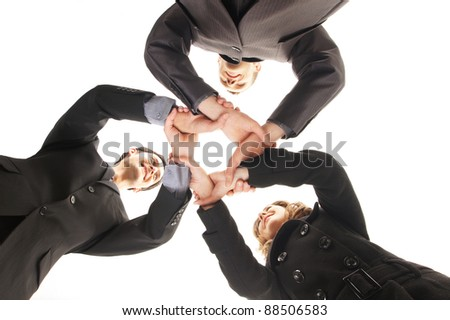 Group handshake with a lot of different hands (FOCUS ON HANDS) - stock photo