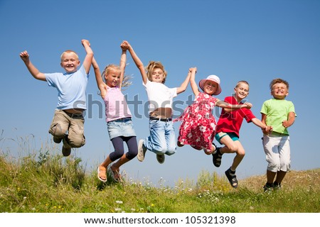 Group  happy children  jumping on summer meadow against blue sky - stock photo