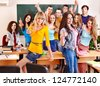 Group happy student in classroom near blackboard. - stock photo