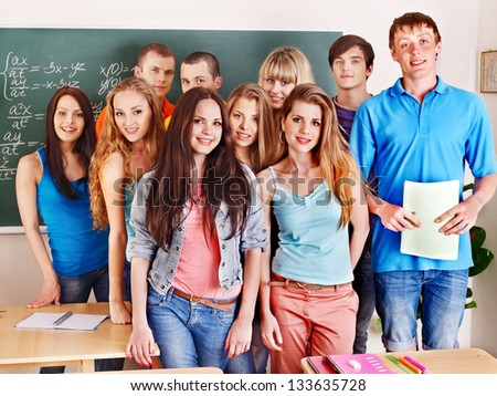 Group happy student near blackboard. - stock photo