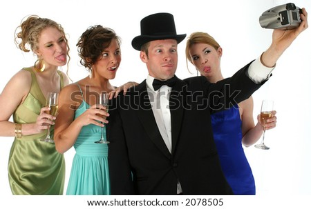 Group in formals making funny faces for camera.