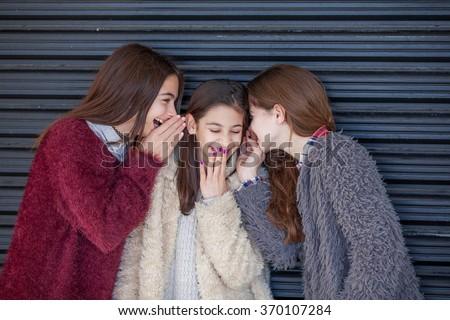 group kids giggling whispering secrets - stock photo