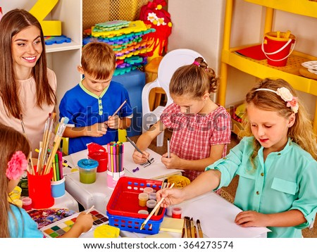 Group kids with teacher woman learnig painting on paper  in  kindergarten .  - stock photo