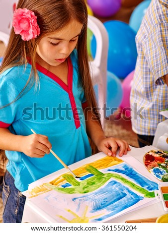 Group little girl with brush painting in  kindergarten .