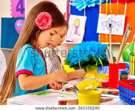 Group little girl with brush painting in  kindergarten . - stock photo