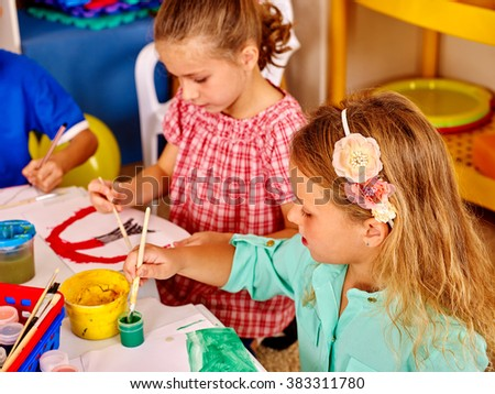 Group little girl with brush painting on table together in  kindergarten .  - stock photo