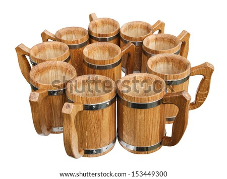 Group oak wooden mugs of beer isolated on white background - stock photo