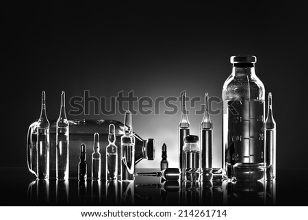 group object of  liquid medicinal agent in  limpid glassware, black-and-white horizontal photo - stock photo