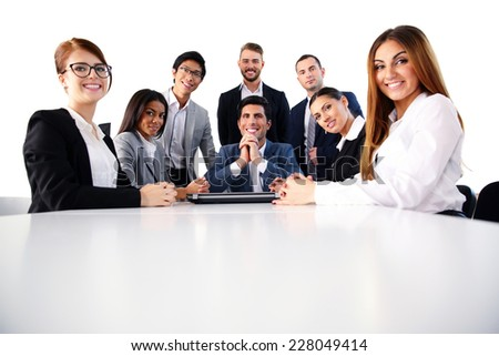 Group of a happy businesspeople on the meeting - stock photo